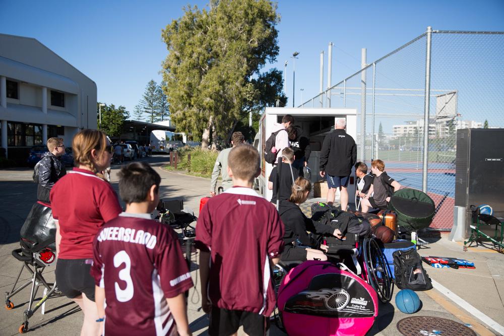 Junior athletes unpacking the trailer at the 2018 junior development camp