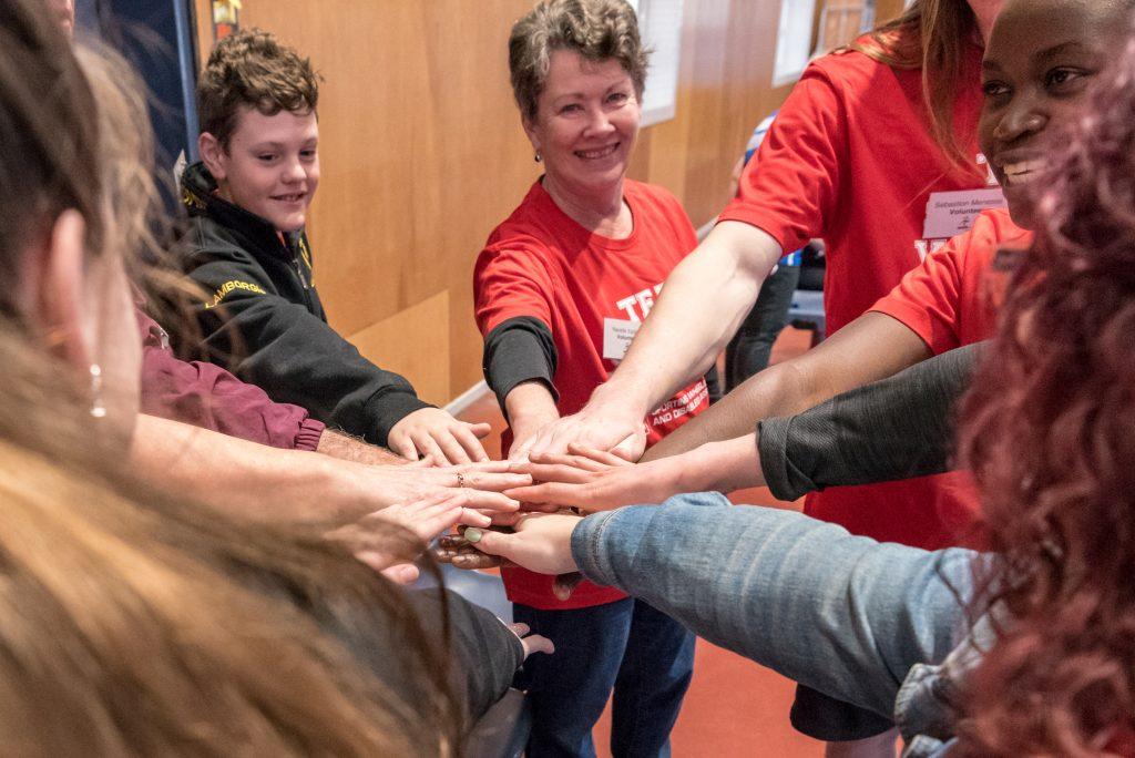 Volunteers hands in together
