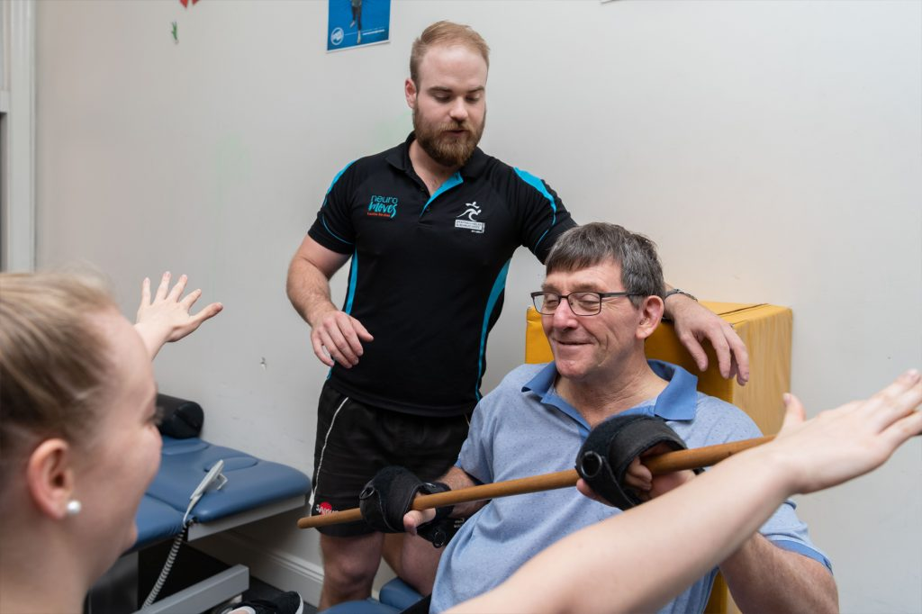 Accredited exercise physiologist working privately with member