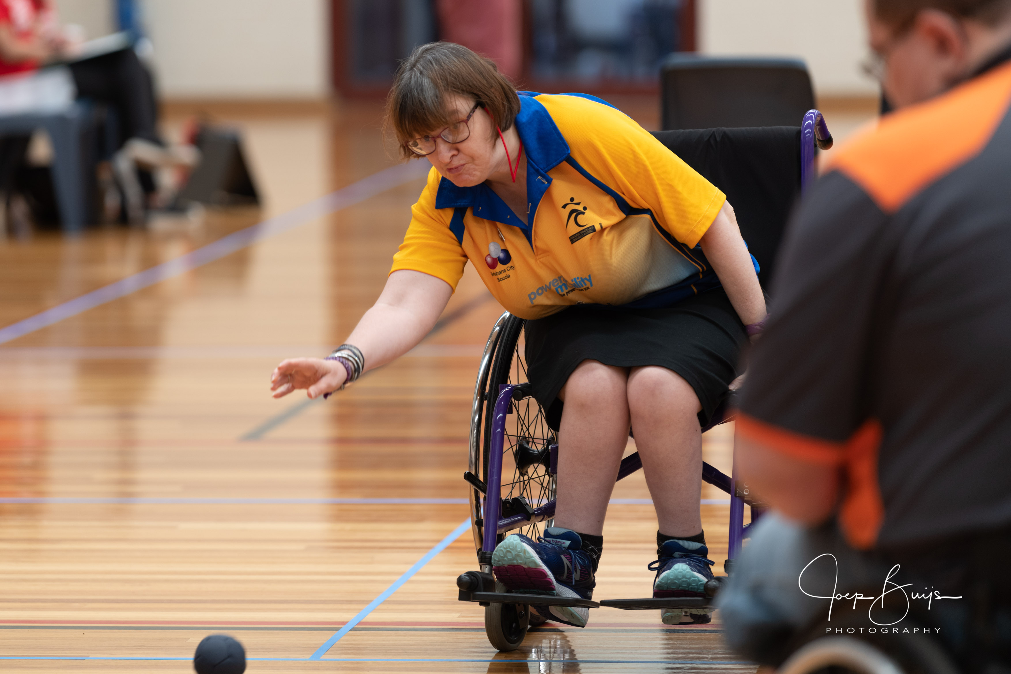 Ladie throwing a boccia ball from her wheelchair