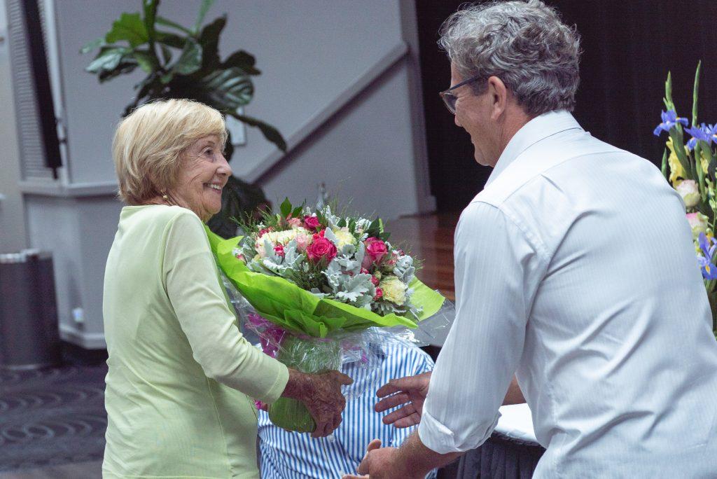 Martin grose handing daphne pririe flowers at 2018 Annual Awards