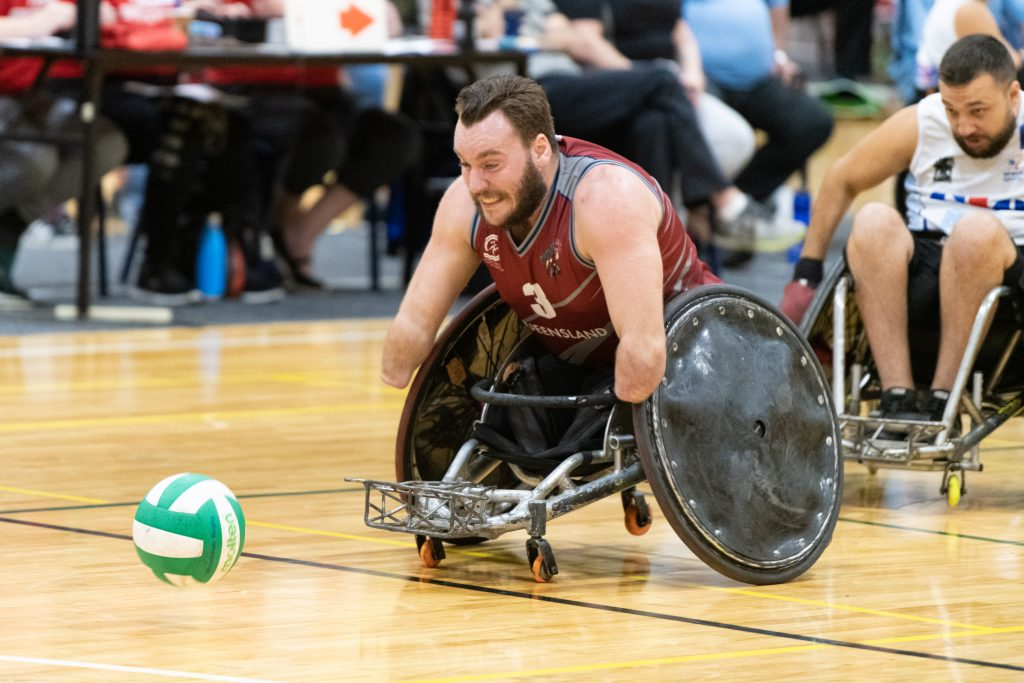 Wheelchair rugby player chasing ball