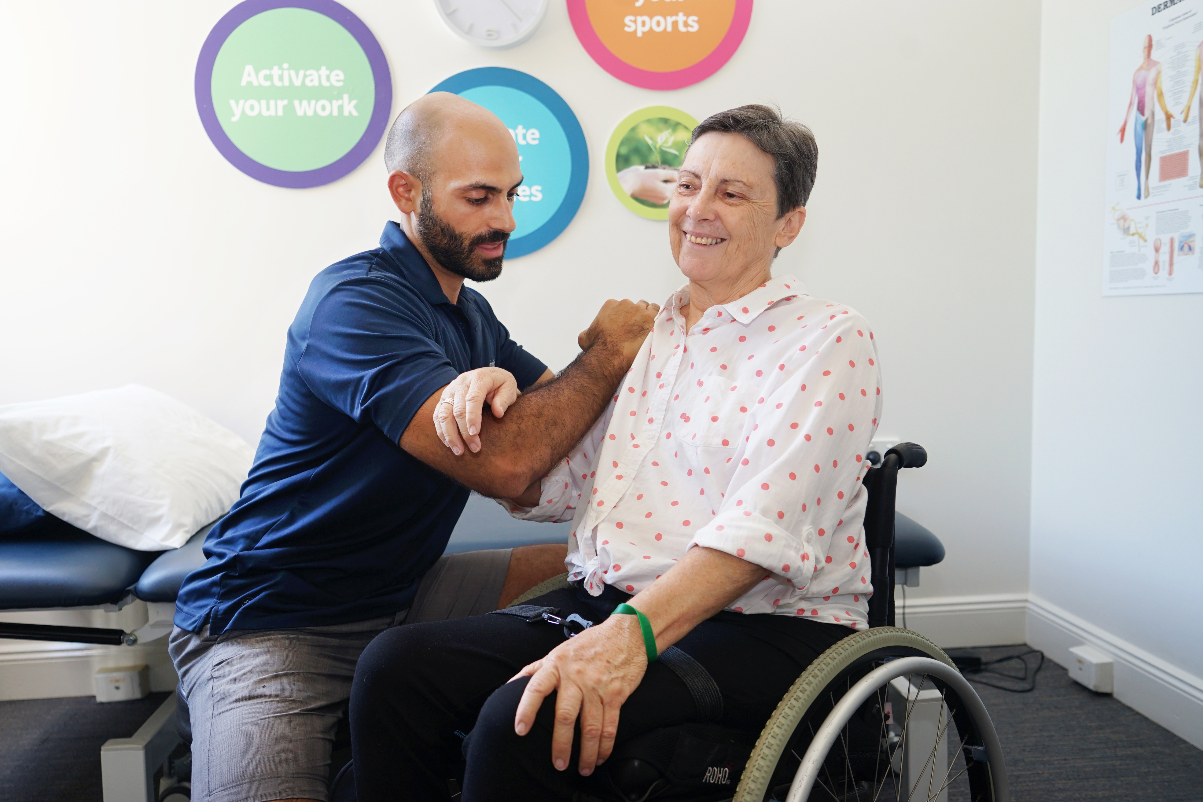 Physio working with member in wheelchair
