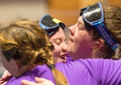 Girls celebrating from a win at the Paralympic Sport of Goalball